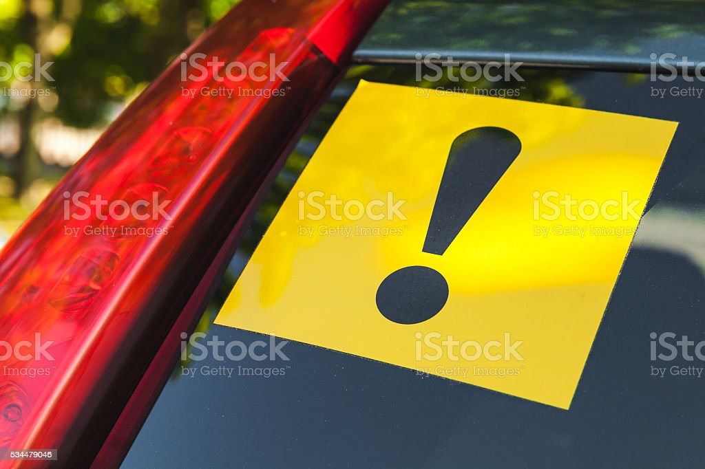 Warning yellow sticker with exclamation sign stock photo