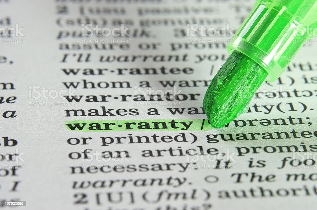 warranty definition highligted in dictionary royalty-free stock photo