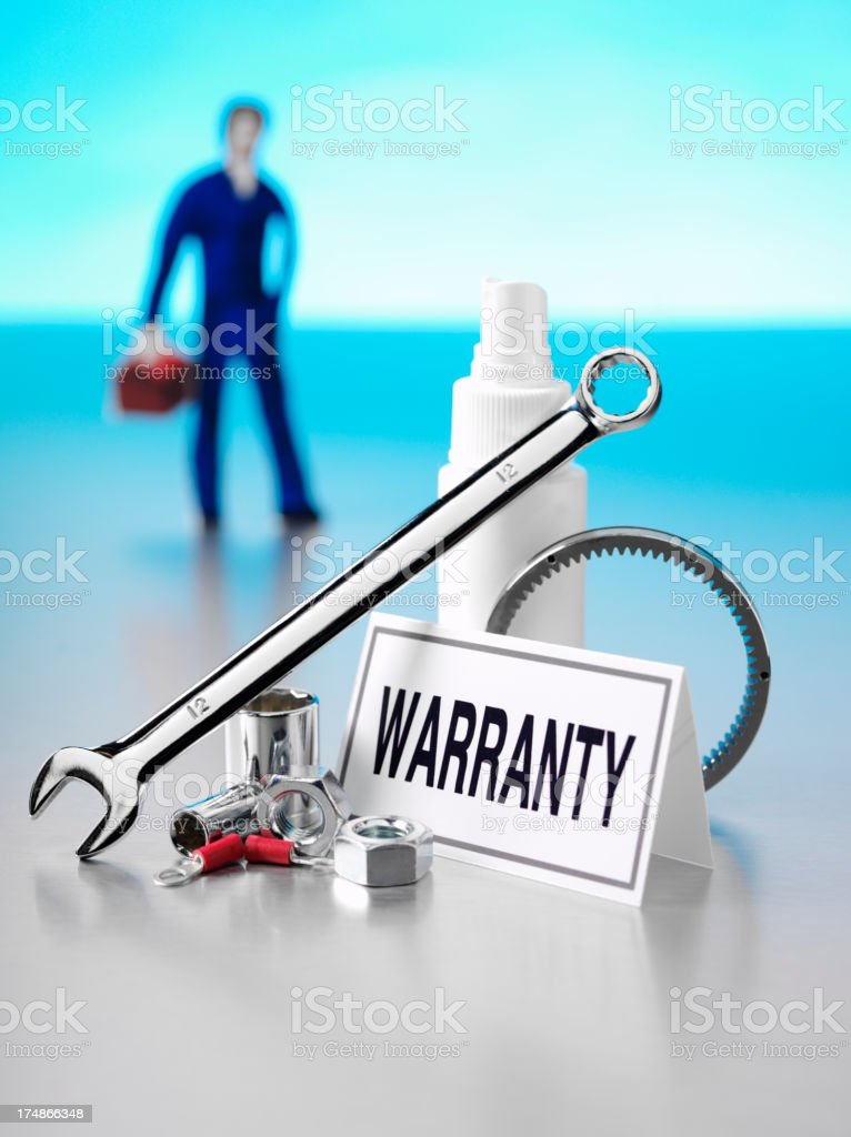 Warranty Label with a Mechanic and Tools royalty-free stock photo