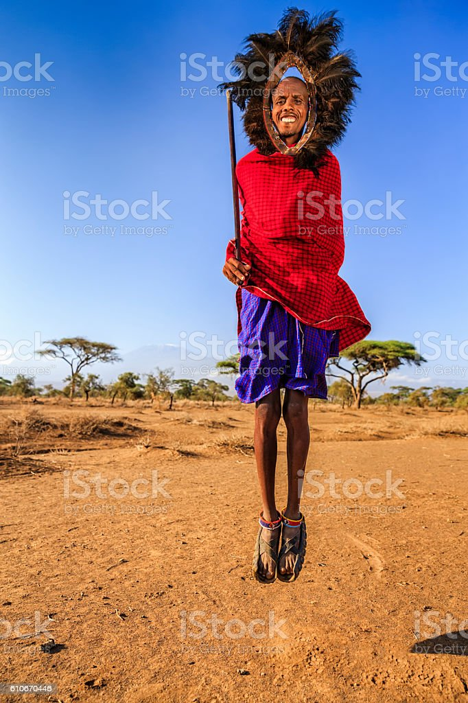 Warrior from Maasai tribe performing traditional jumping dance, Kenya, Africa stock photo