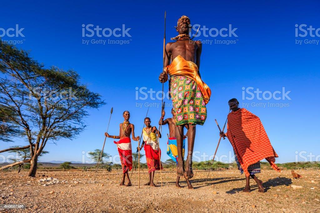 Warrior from Samburu tribe performing traditional jumping dance, Kenya, Africa stock photo