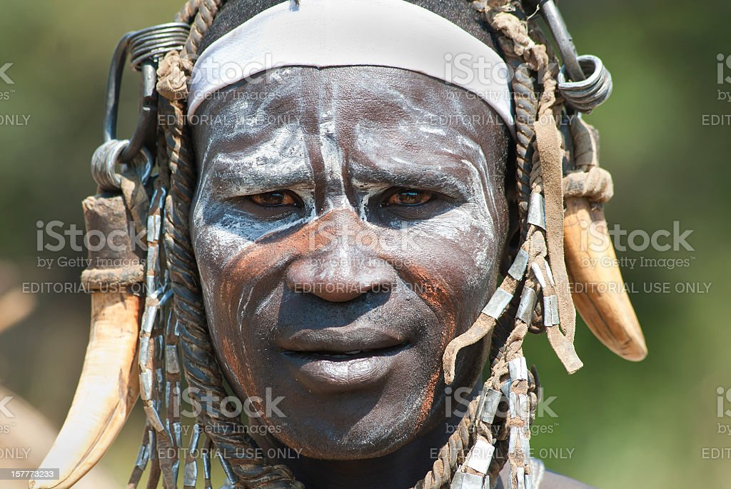 Warrior from the Mursi tribe in Southern Ethiopia stock photo