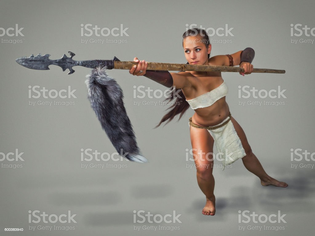 Warrior  girl ancient. Poke with a spear. stock photo