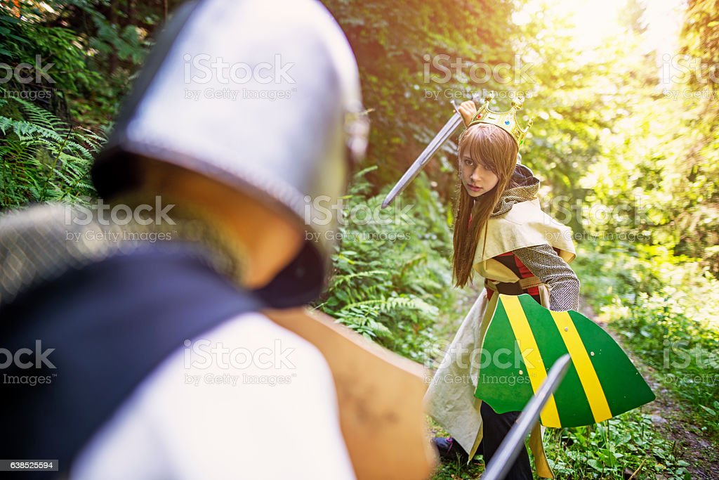 Warrior princess fighting with a knight stock photo