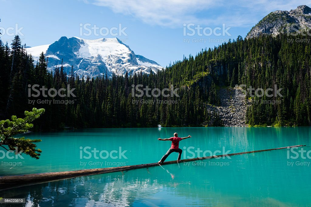 Warrior two lakeside yoga stock photo
