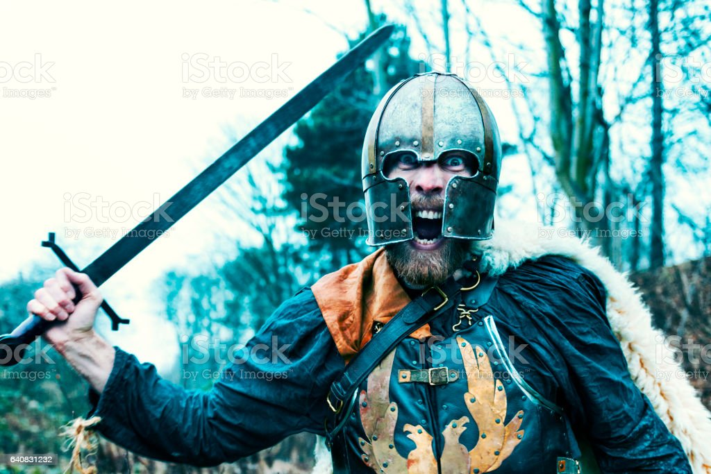 Warrior with sword attacks and screams stock photo