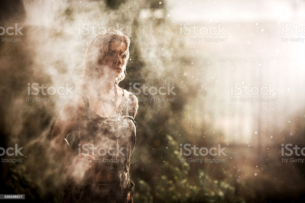 Warrior woman at rain. stock photo