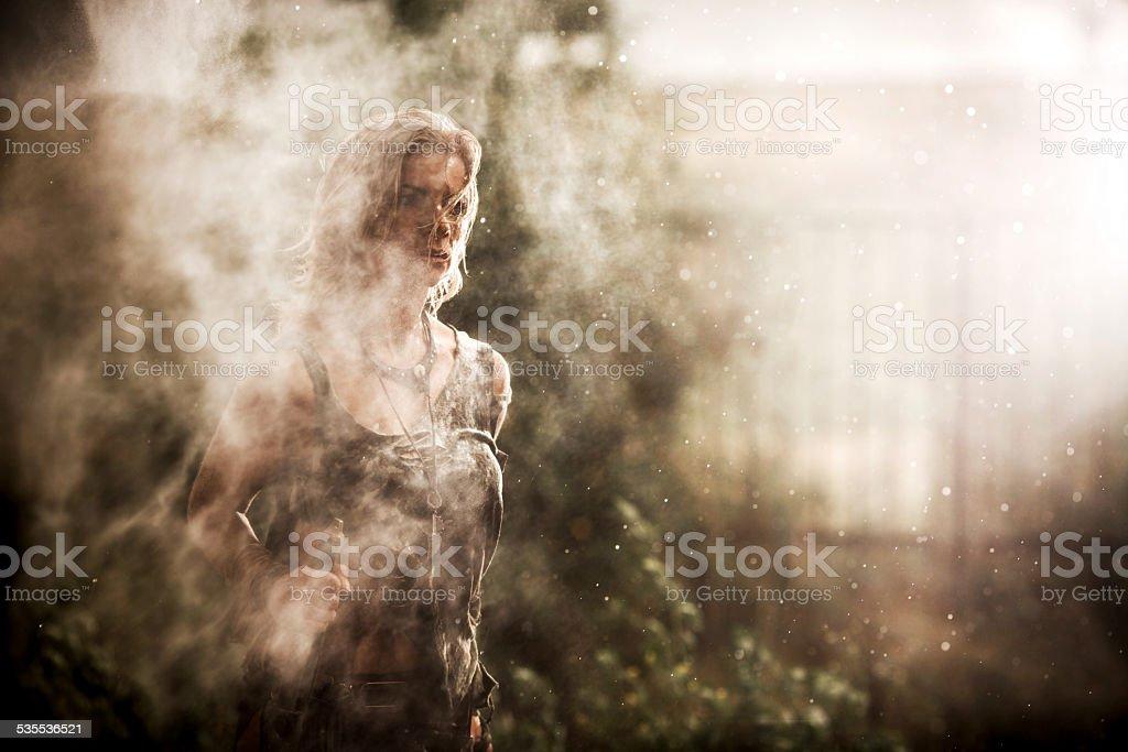 Warrior woman at rain. stock photo
