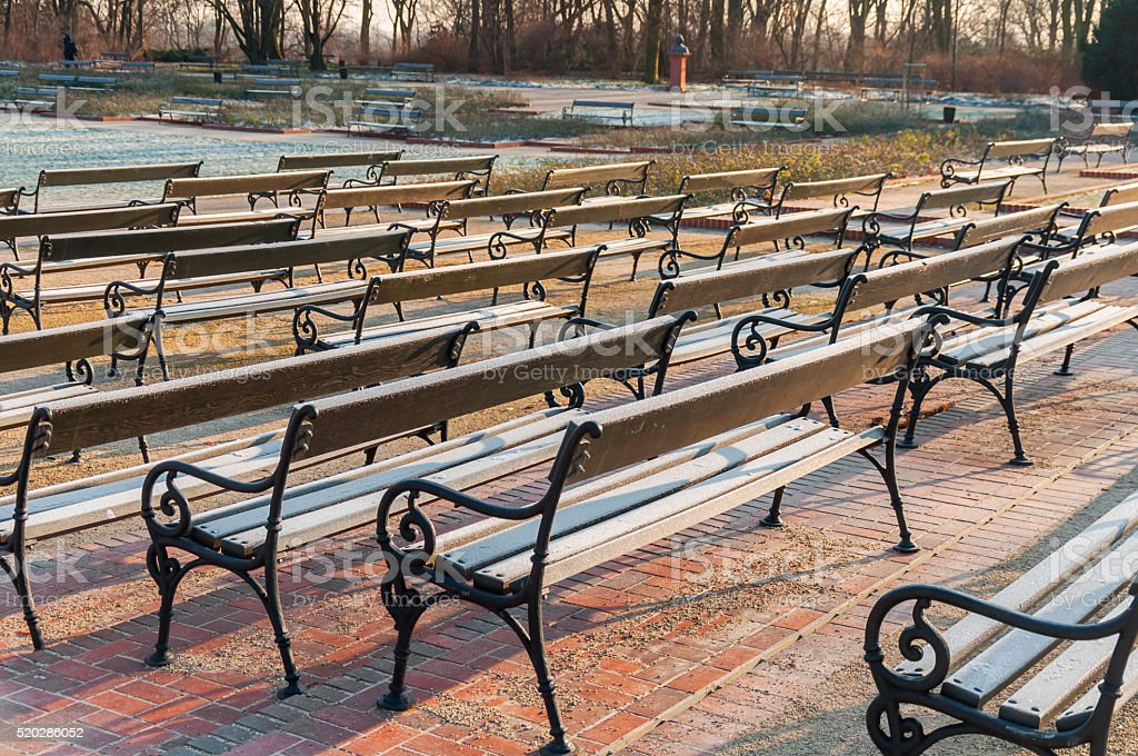 Warsaw, Poland Famous Ujazdow park and lot of bench stock photo