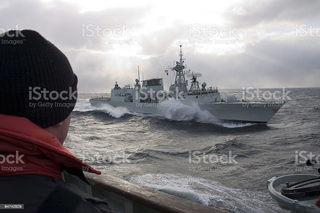 Warship in the middle of the sea stock photo