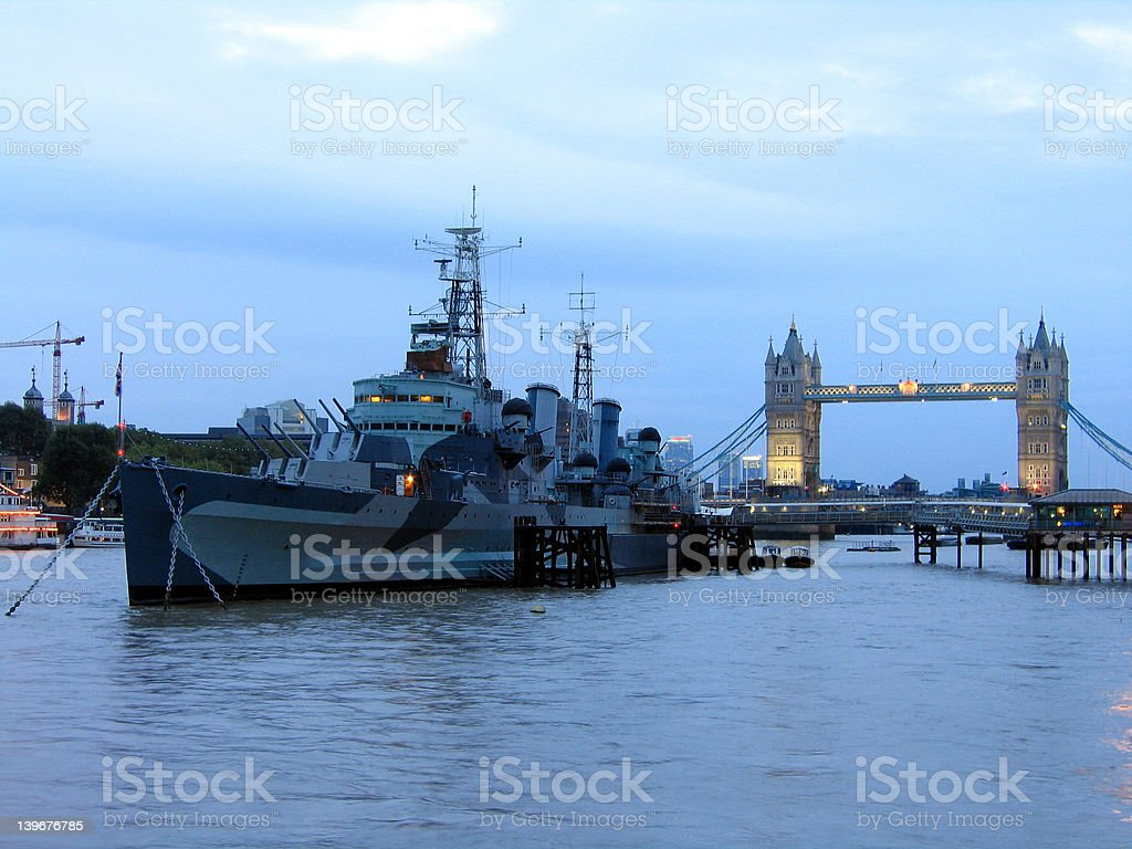 Warship near Tower Bridge in London royalty-free stock photo