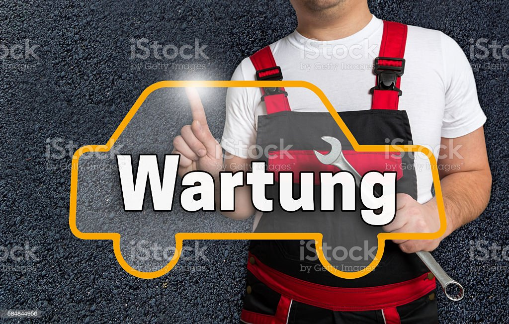 Wartung (in german service) touchscreen operated by car mechanic stock photo