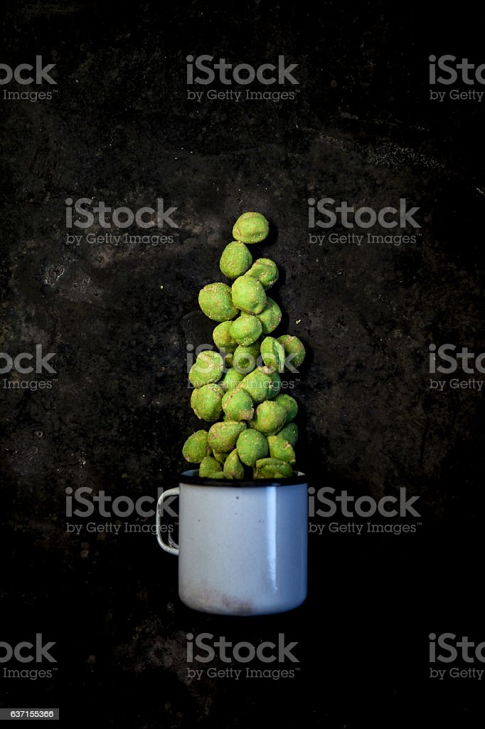 wasabi peanuts on black background stock photo