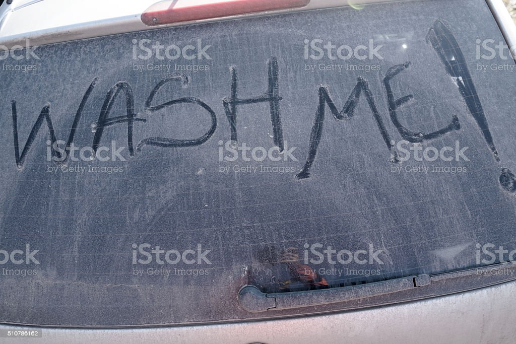 Wash me text on dirty windshield stock photo