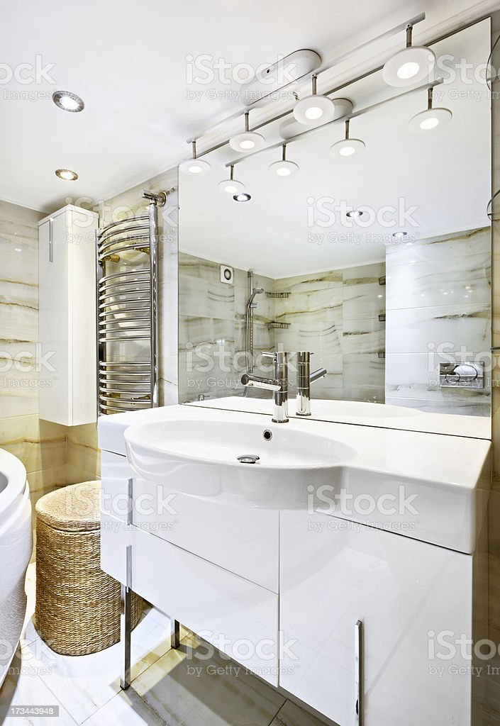 Wash stand with mirror in modern white bathroom interior stock photo