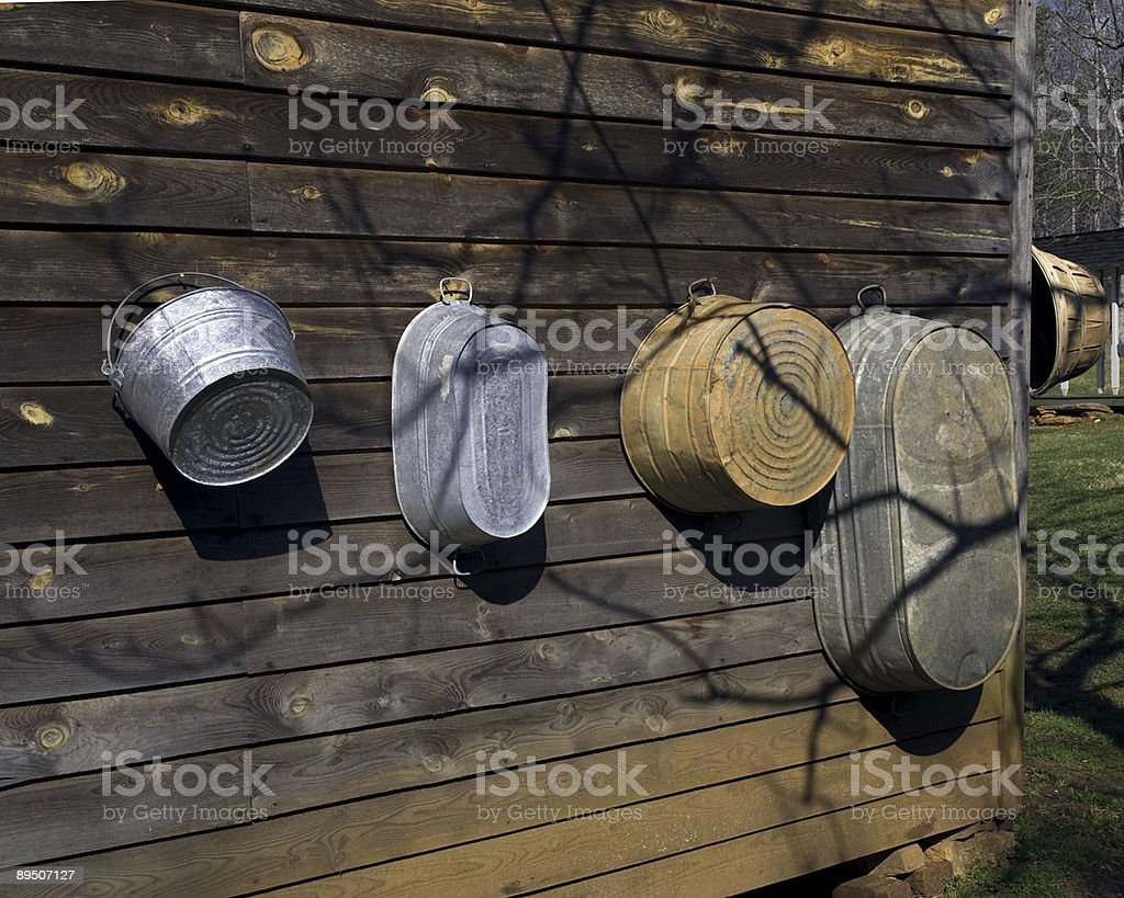 Wash Tubs Lined Up on a Barn Wall royalty-free stock photo