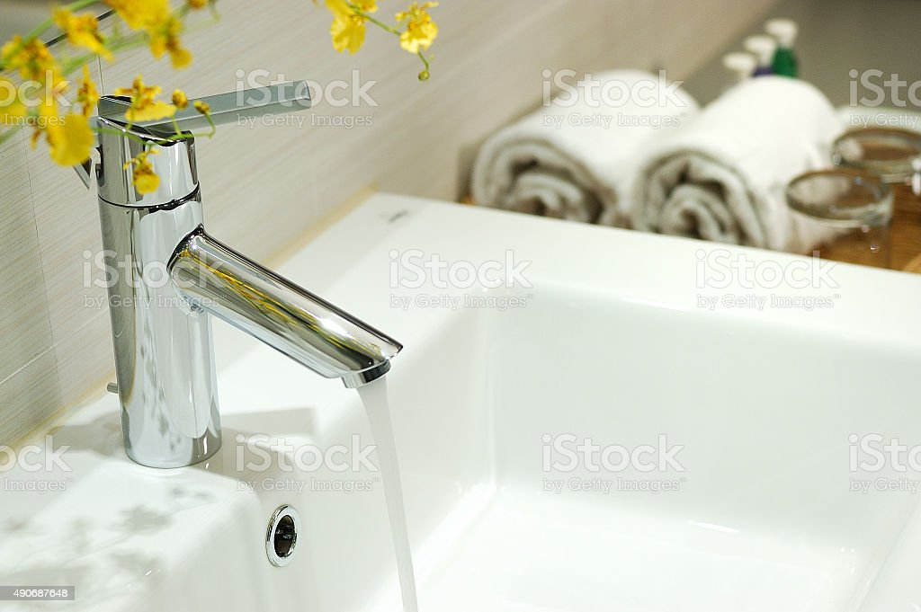 washbasin and faucet in bathroom stock photo