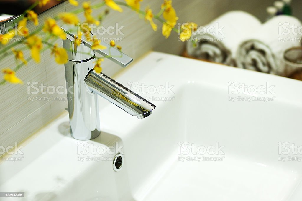 washbasin and faucet in bathroom. stock photo
