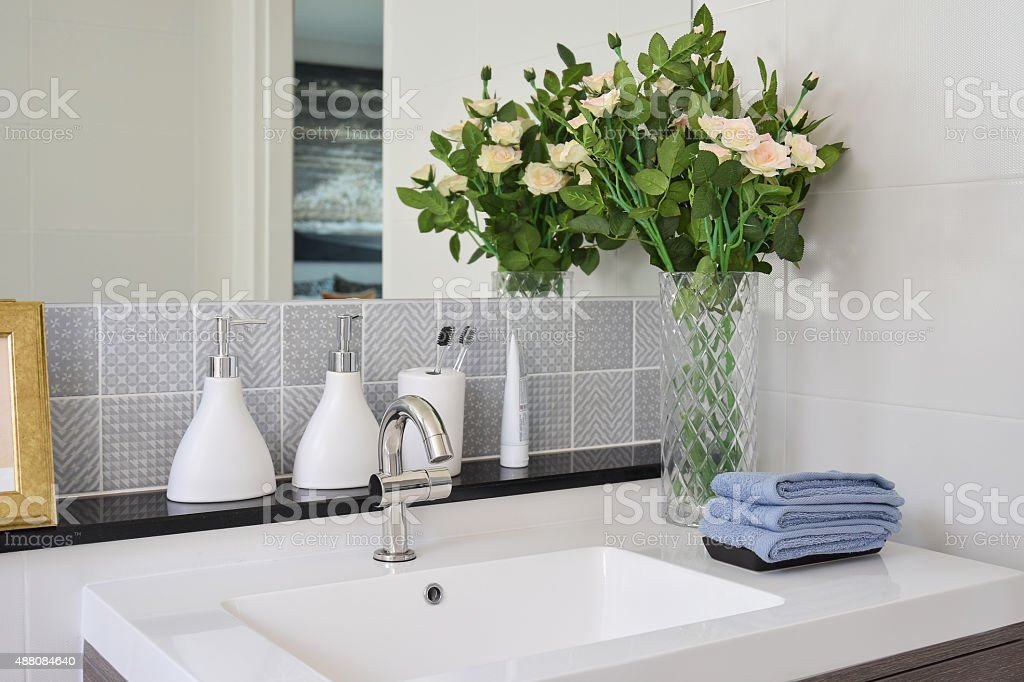 washbasin with faucet and liquid soap bottle at home stock photo