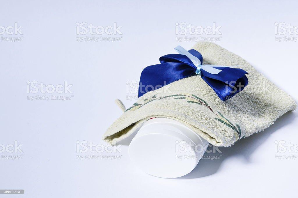Washcloth and lotion stock photo