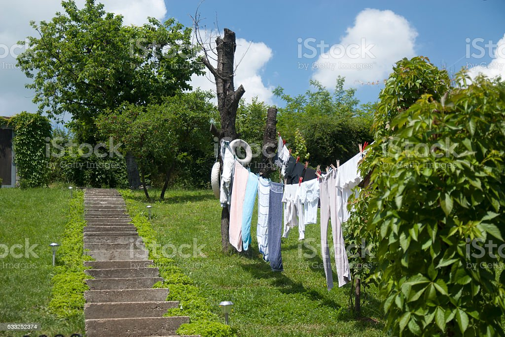 Washed laundry on a rope stock photo