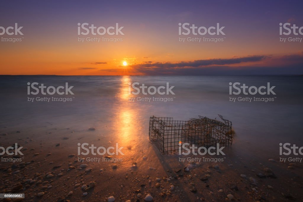 Washed up crab cage sunset in the Bay stock photo