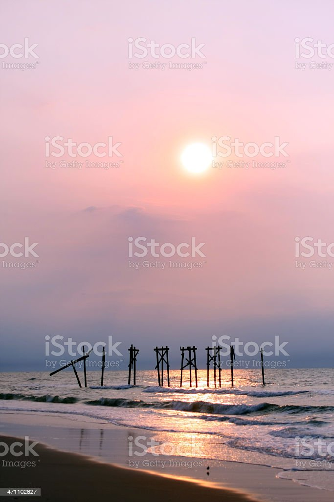 washed-out pier at sunrise stock photo