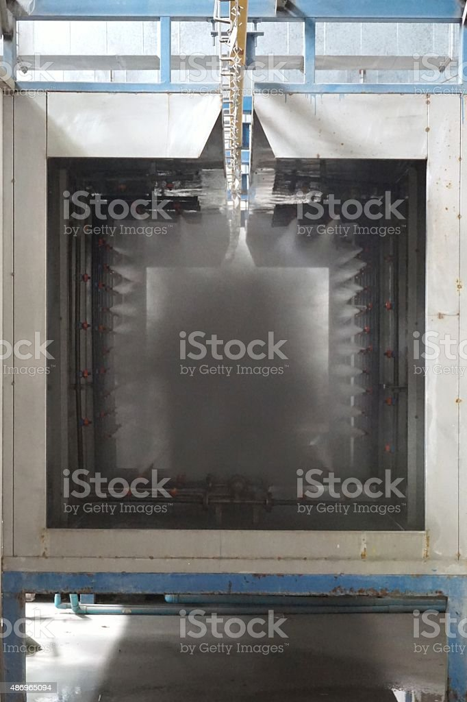 washer water spray booth stock photo