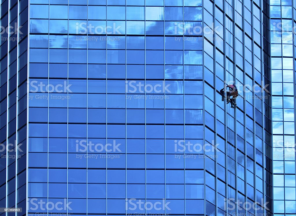 Washerman on a business building facade royalty-free stock photo