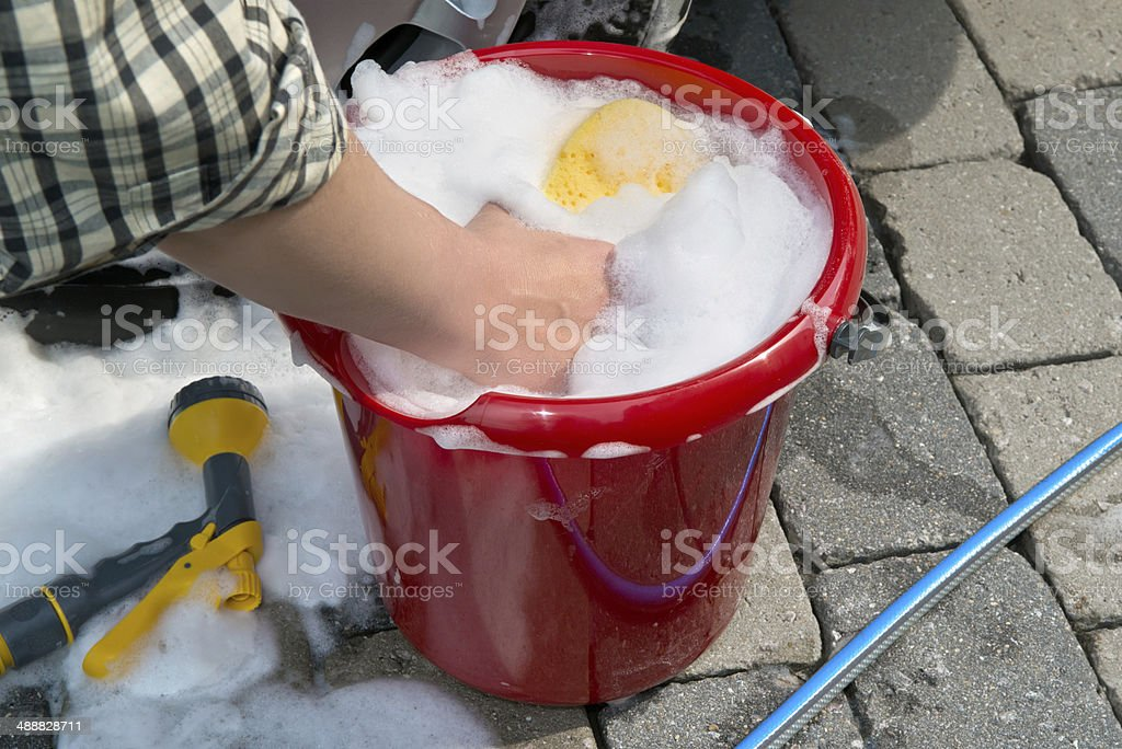 washing a car by hand stock photo