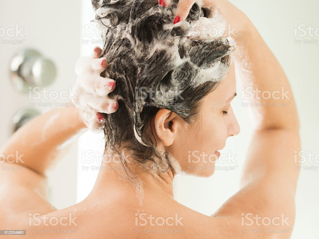 Washing a hair stock photo