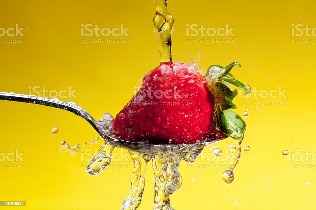 Washing a Strawberry royalty-free stock photo