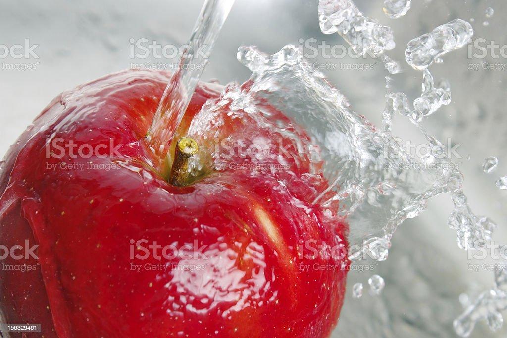 Washing apple royalty-free stock photo