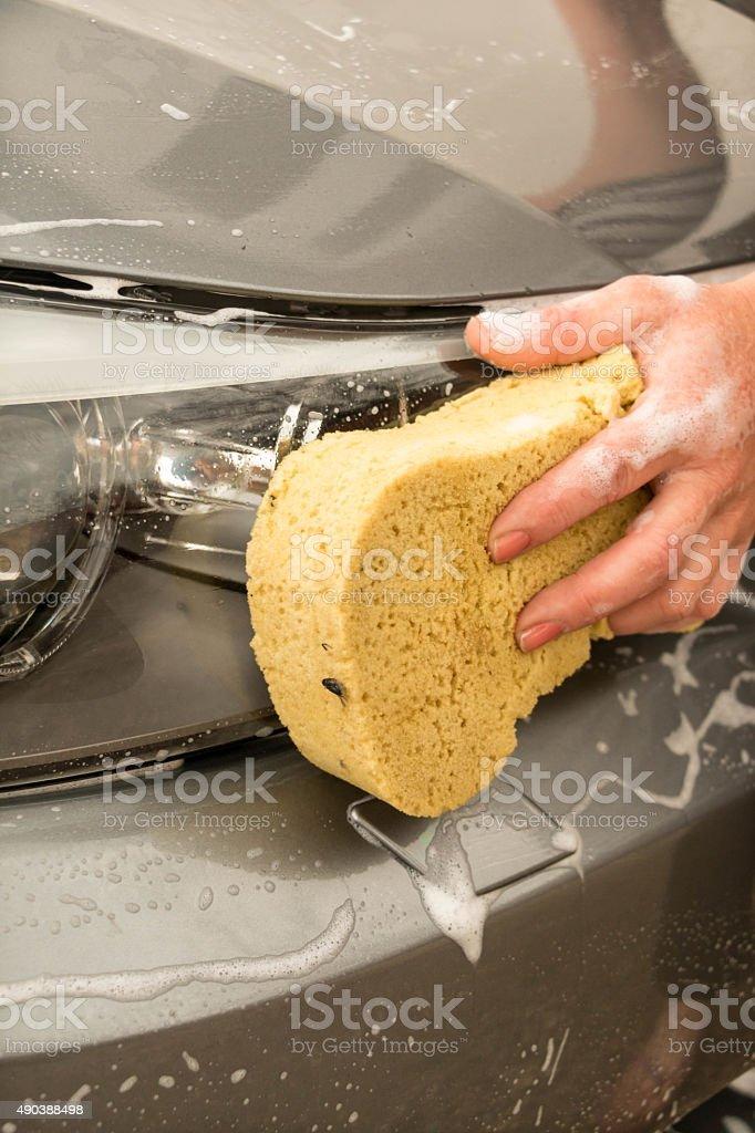 Washing car's lights stock photo