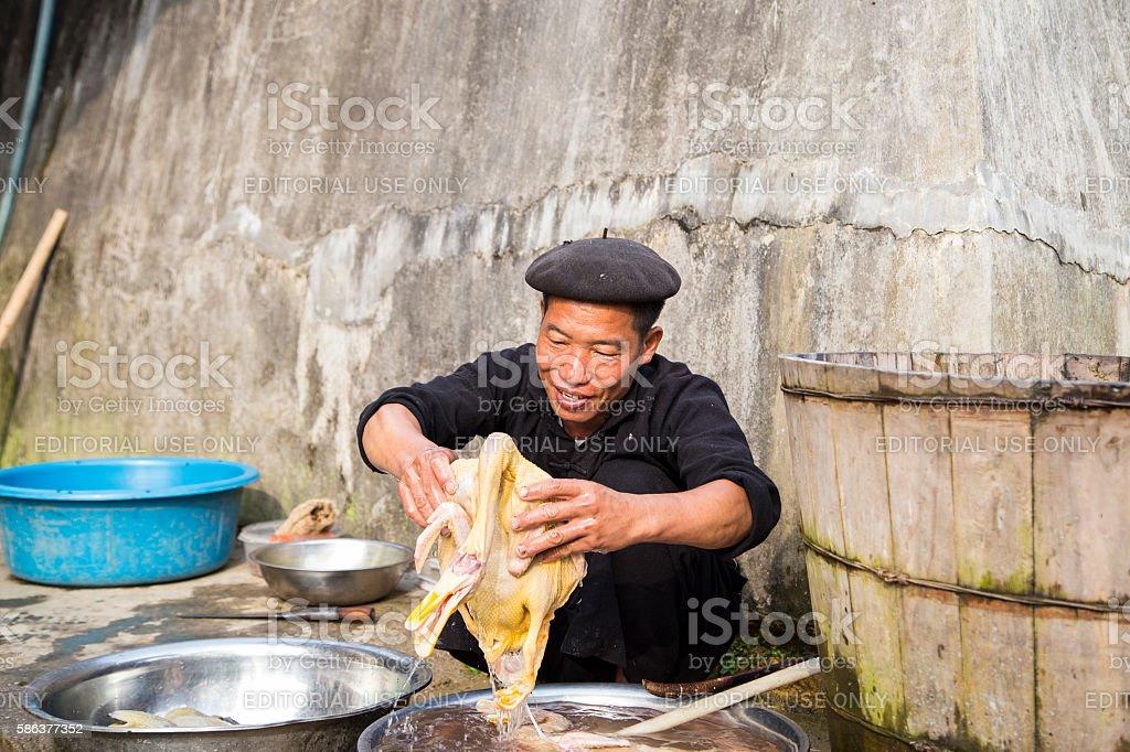 Washing chicken stock photo