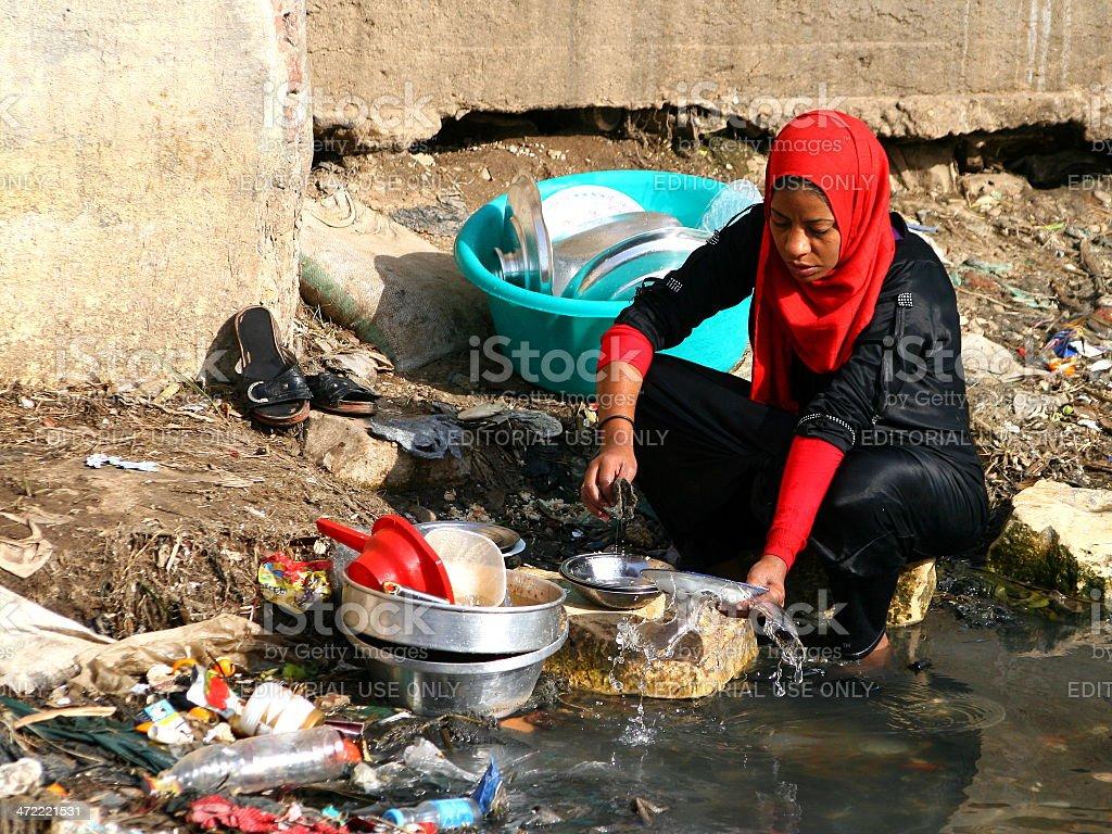 Washing dish at river stock photo