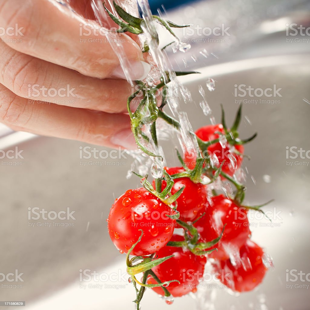 washing fresh vegetables royalty-free stock photo