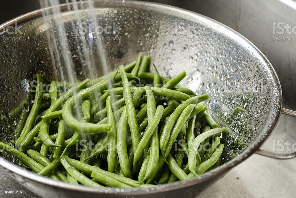 Washing Green Beans stock photo
