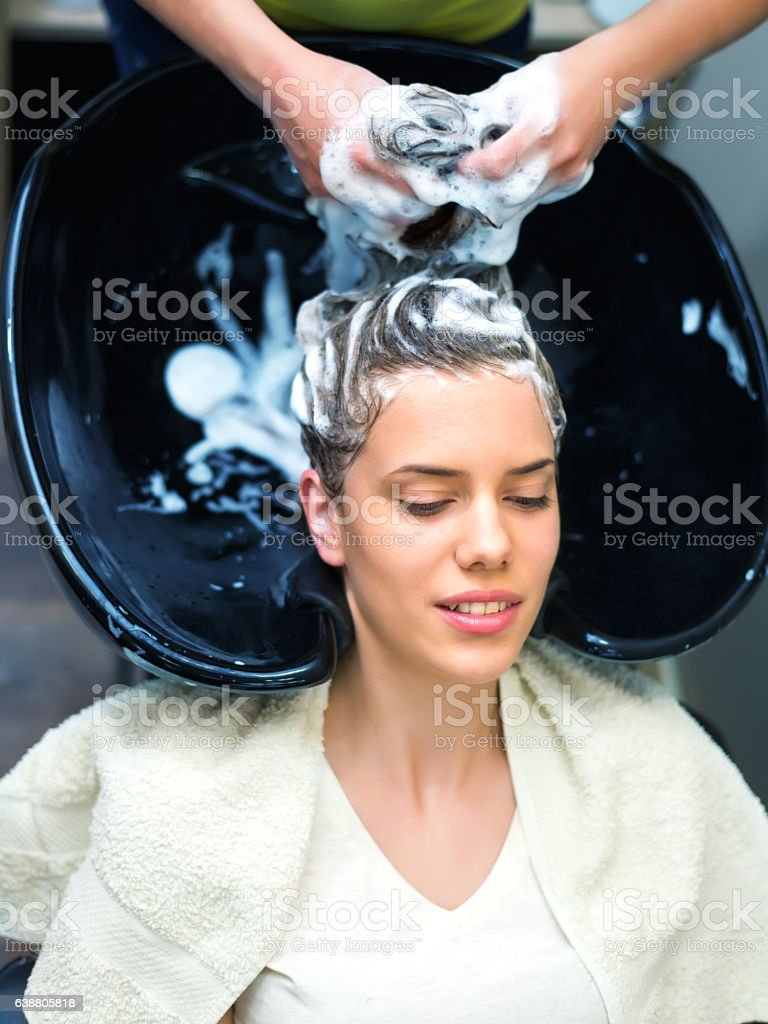 Washing Hair in Hair Salon stock photo