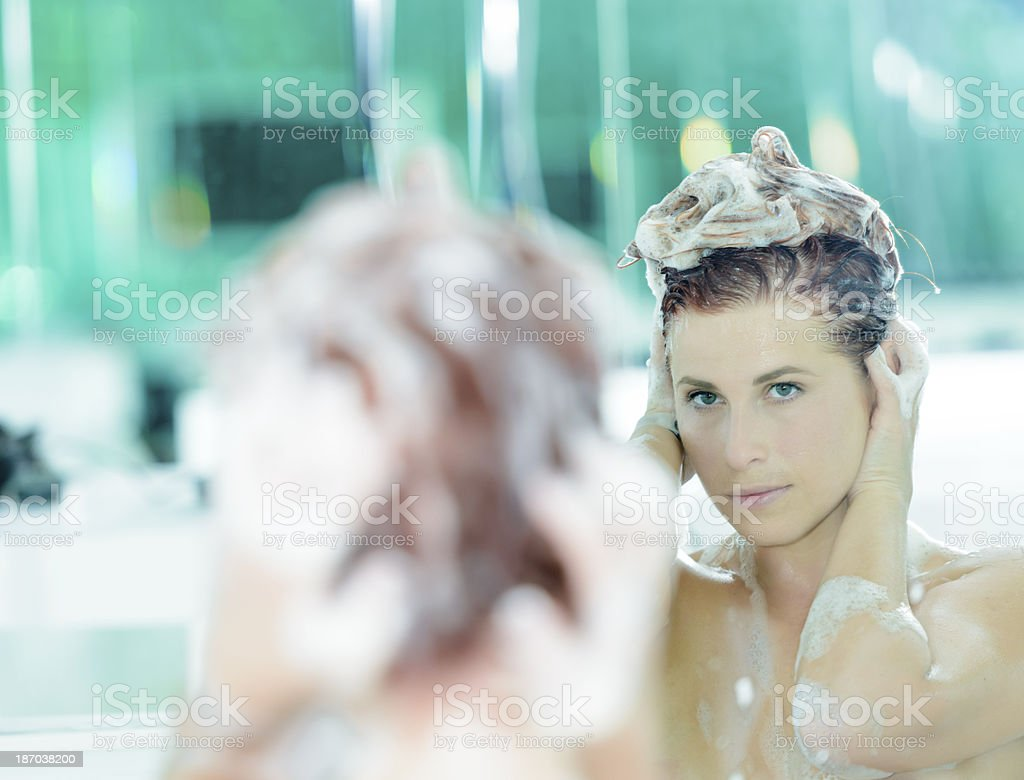 washing hair in mirror royalty-free stock photo