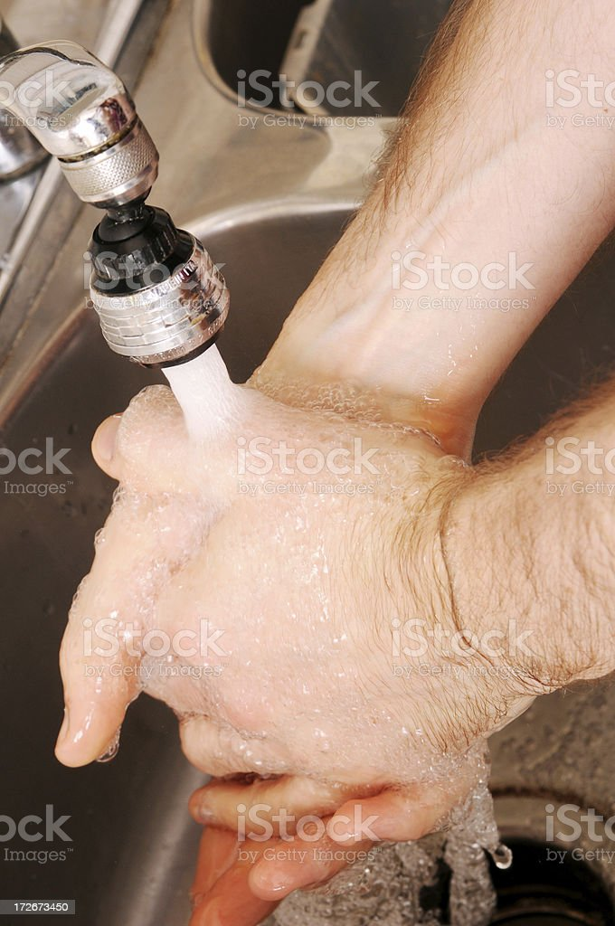 Washing Hands in the Kitchen Sink royalty-free stock photo