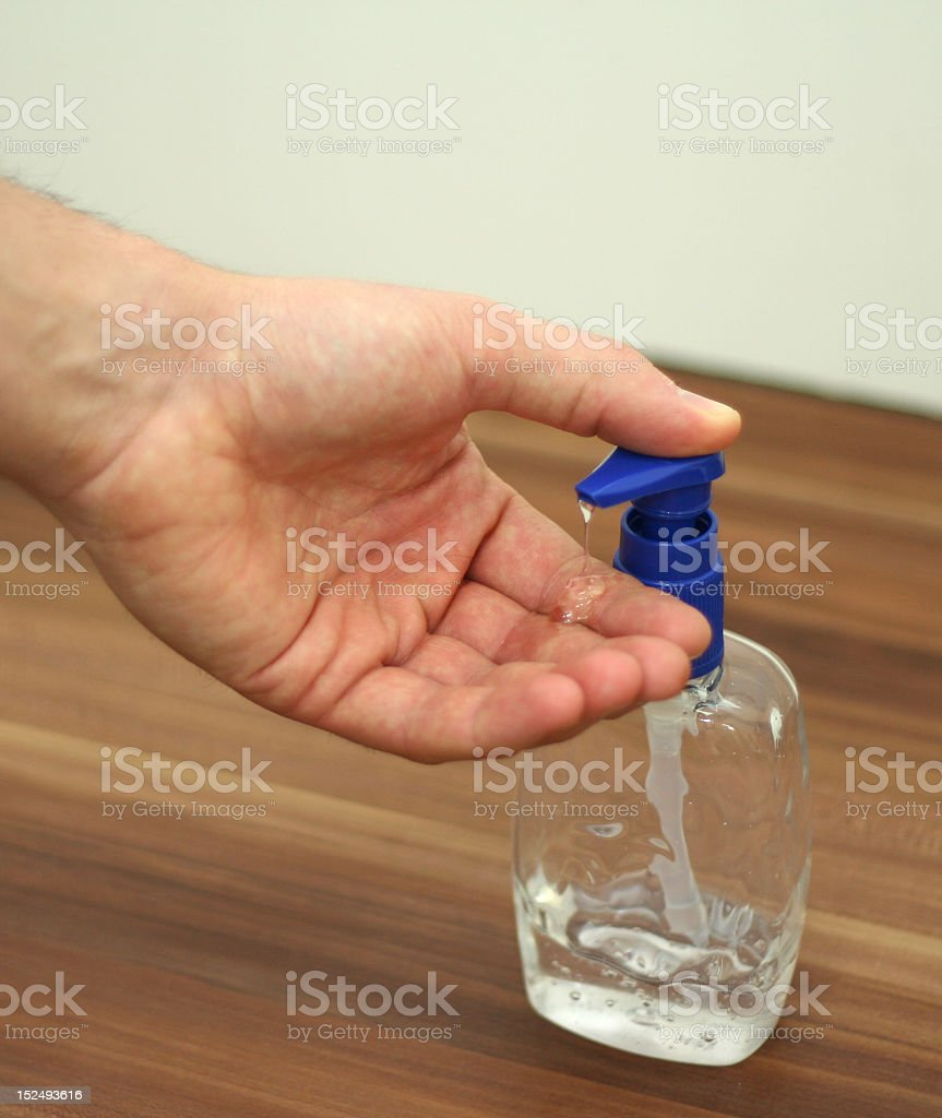 Washing hands with gel sanitizer stock photo