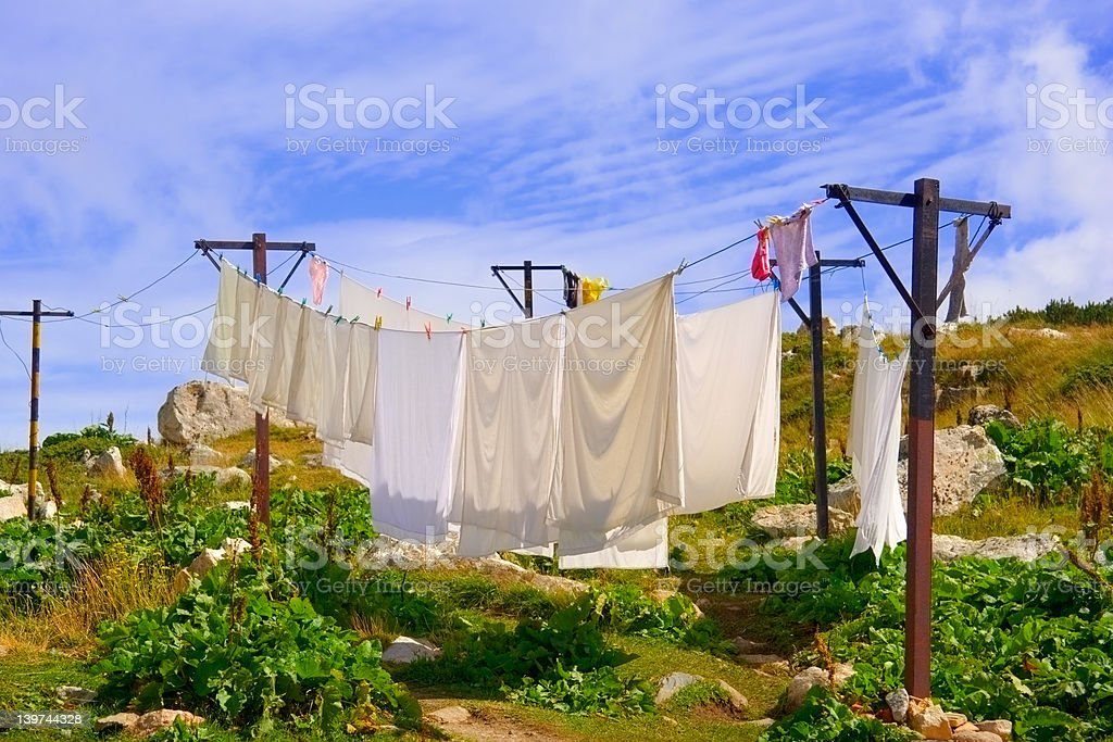 Washing hanging on a clothesline outdoors royalty-free stock photo