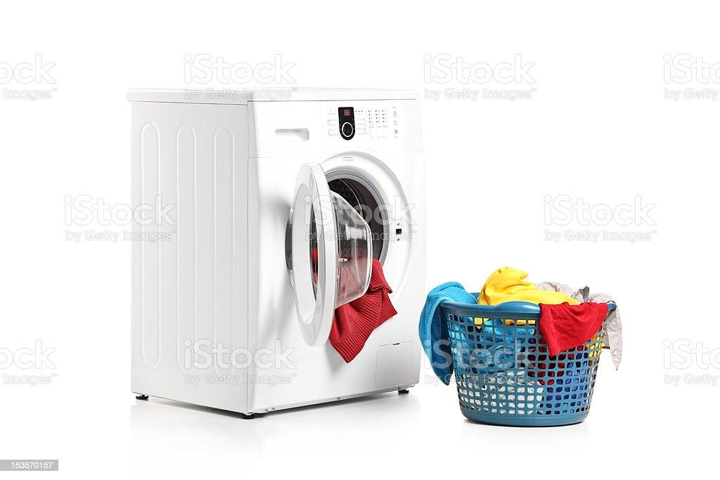 Washing machine and full laundry bin stock photo