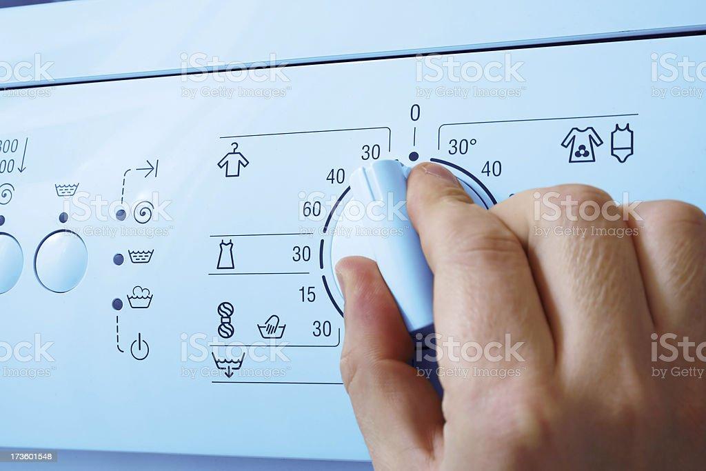 Washing machine and hand stock photo