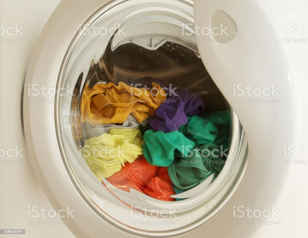 Washing machine full of dirty clothes stock photo