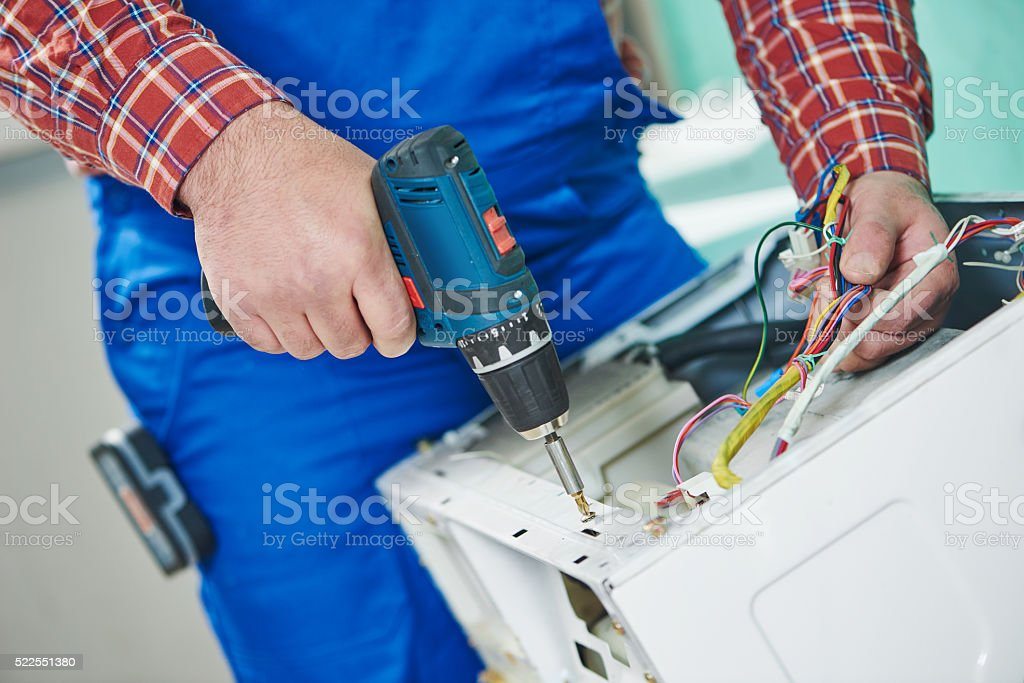 washing machine repair stock photo
