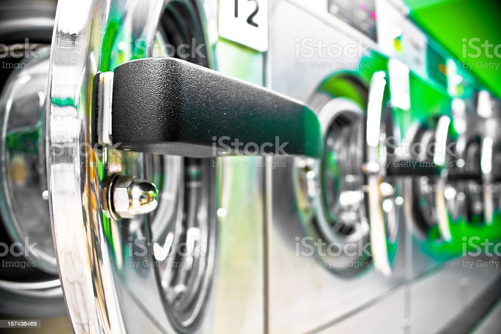 Washing machine row with open door royalty-free stock photo