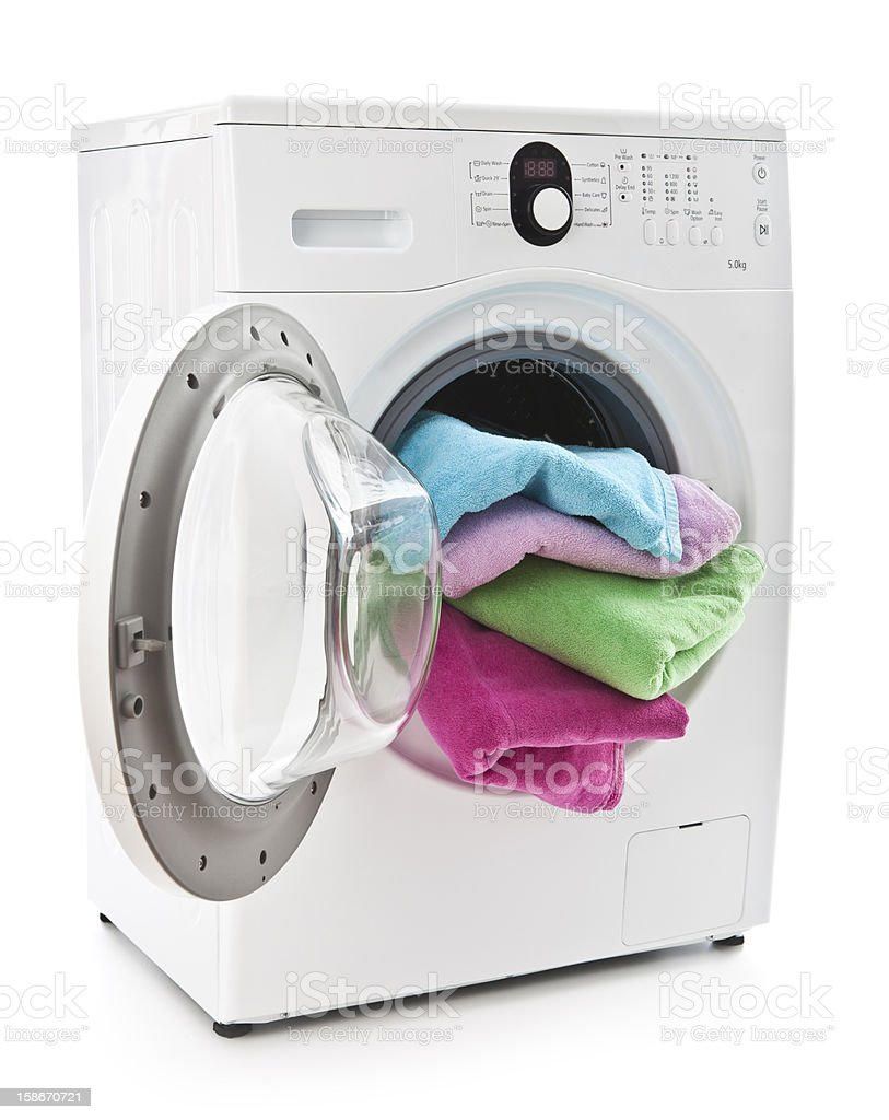 Washing machine with colorful laundry stock photo