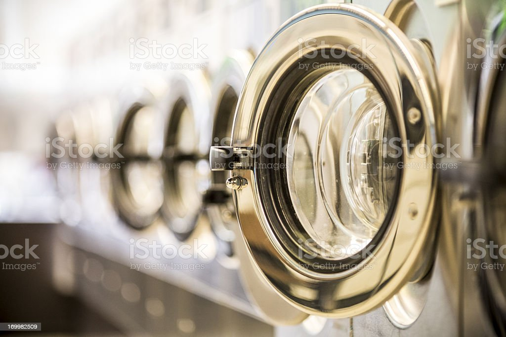 Washing machines - clothes washer's door in a public launderette royalty-free stock photo